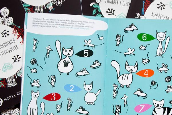 ilustracja kotów jako zagadka w książeczce