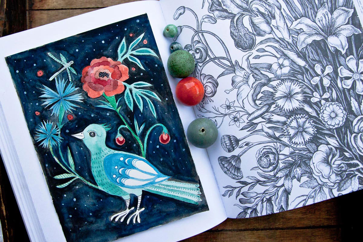 ilustracja ptaka i kwiatów w książce